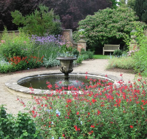 Fountain at the centre of a small walled garden at Newby Hall in Yorkshire.